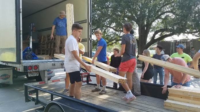 Members of the Orange Texas Stake unload a truck of emergency supplies delivered on Saturday, Aug. 29, 2020. The supplies will help with relief efforts for those impacted by Hurricane Laura.