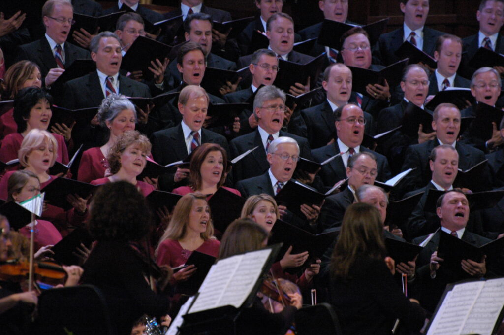 Ruth Crosland, at photo center, performs with the Tabernacle Choir and Orchestra at Temple Square prior to the 2020 pandemic. Crosland is a 13-year veteran of the choir.