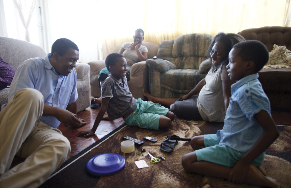 A family in South Africa plays a game together.