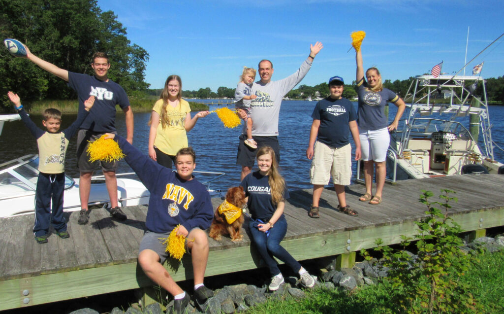The Weibell family lives in the Annapolis, Maryland, area and have loyalties to both Brigham Young University and the United States Naval Academy. Back row, from left, Jonah, Tim, Sabrina, Molly, Benjamin, Zack and Nancy. Front, Benson, Merlin the dog, and Audrey.