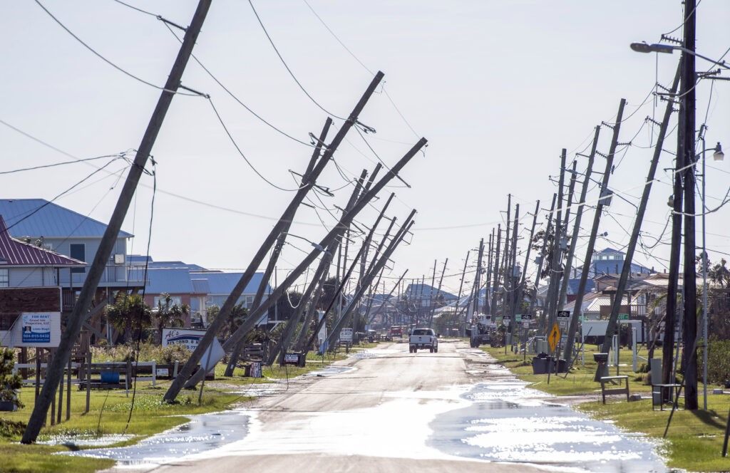 Power poles lean or are broken due to Hurricane Zeta damage Oct. 29, 2020, in Grand Isle, Louisiana. The 2020 Atlantic hurricane season was the largest of record, prompting several Latter-day Saint-sponsored relief projects.