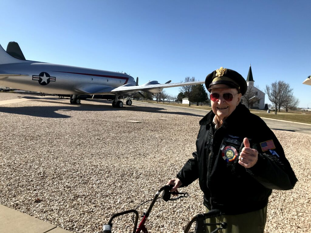 "Last March, Gail Halvorsen, known by many as the ""Berlin Candy Bomber,"" visited The Hill Air Force Base Museum while being interviewed by a film crew from London. Halvorsen is standing next to a C-54 Skymaster airplane."