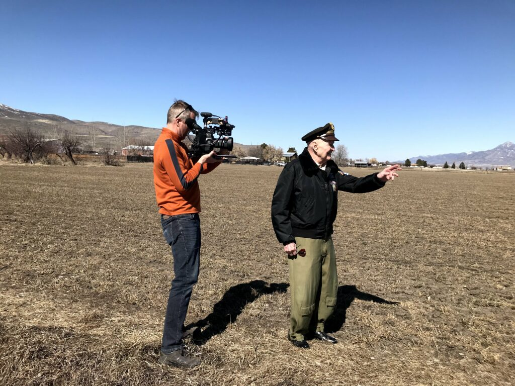 "Last March, Gail Halvorsen, known by many as the ""Berlin Candy Bomber,"" visited his hometown of Garland, Utah. He is standing in the sugar beet field behind his parent's home where he worked as a boy and first saw airplanes fly overhead. During the visit he was interviewed by a film crew from London."