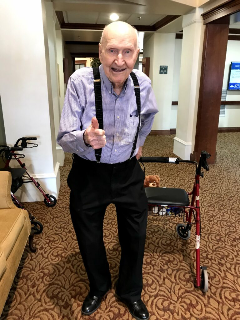 "Gail Halvorsen, known by many as the ""Berlin Candy Bomber,"" gives a thumbs up."