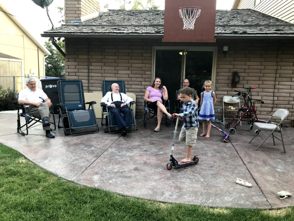 "Second from the left, Gail Halvorsen, known by many as the ""Berlin Candy Bomber,"" relaxes with family members in the backyard."