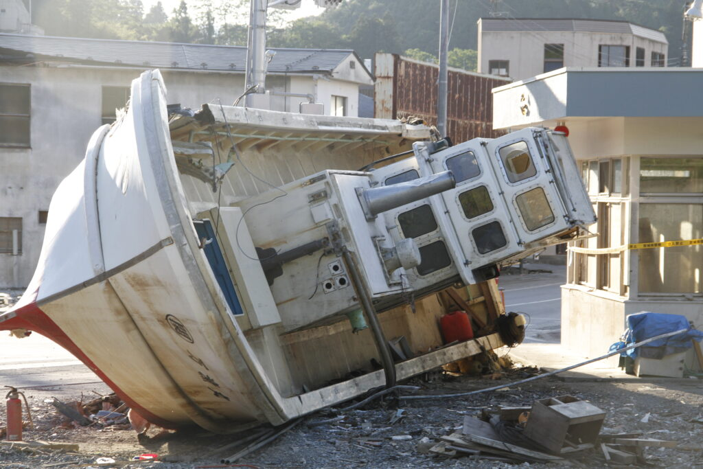 On June 15, 2011, three months after earthquake and tsunami in Japan, a boat stands as reminder of destruction in Higashi Matsushima, Japan, a coastal community devastated by the disaster.