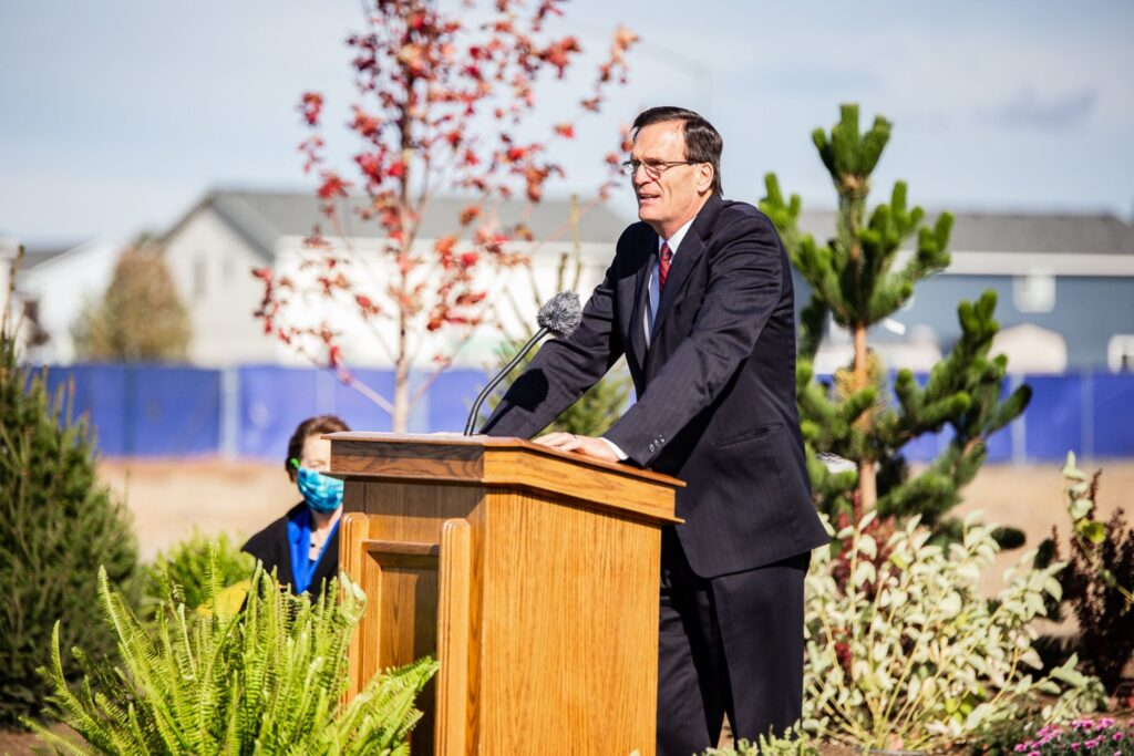 Elder David L. Stapleton, an Area Seventy, conducts the groundbreaking ceremony of the Moses Lake Washington Temple on Saturday, October 10, 2020.