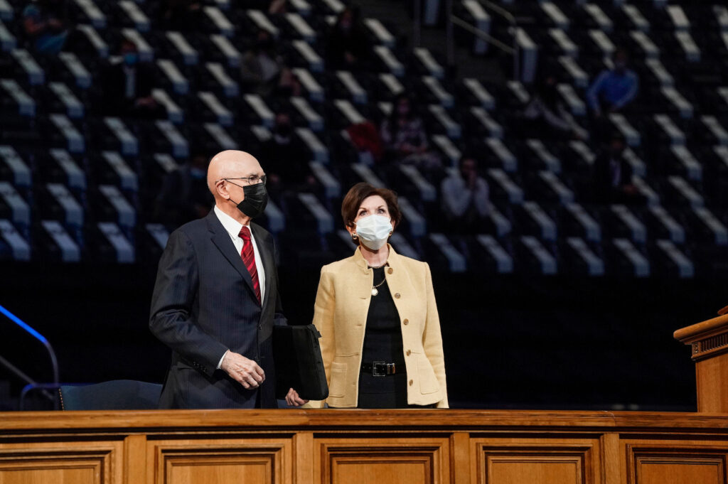 President Dallin H. Oaks and his wife, Sister Kristen Oaks, enter the Marriott Center on BYU campus prior to President Oaks offering the campus devotional on Tuesday, Oct. 27, 2020.