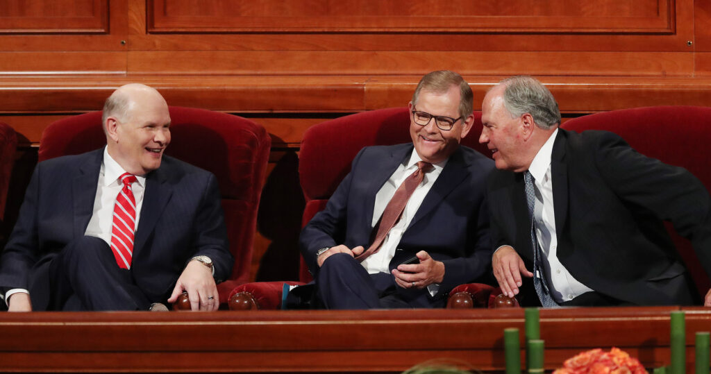 Elder Dale G. Renlund, left, Elder Gary E. Stevenson, middle, and Elder Ronald A. Rasband of the Quorum of the Twelve Apostles talk prior to the Sunday afternoon session of the 188th Semiannual General Conference of The Church of Jesus Christ of Latter-day Saints in the Conference Center in Salt Lake City on Sunday, Oct. 7, 2018.
