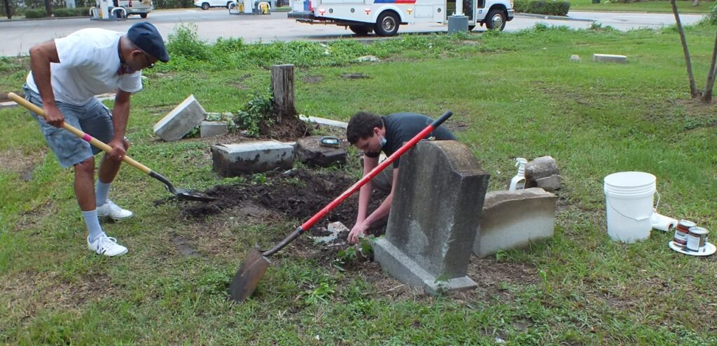 MacGregor Ward Bishop Victor Migenes, left, and Elder Nicholas, right, a Church service missionary, repair a grave plot at Historic Evergreen Negro Cemetery in Houston, Texas, on Saturday, Oct. 17, 2020.