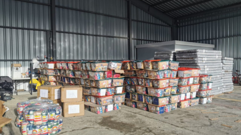 Plastic bins with food donations were stacked on a warehouse floor in Guatemala City, Guatemala, before being transported to people impacted by Hurricane Eta in November 2020.
