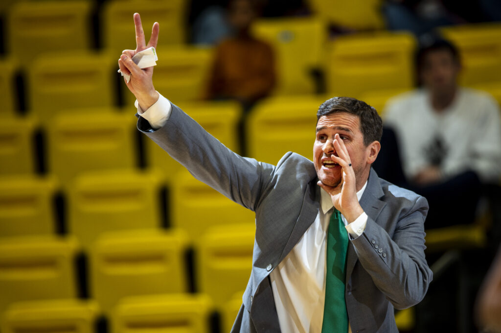 Utah Valley University Men's Basketball Coach Mark Madsen shouts instruction to his team during game against the Northern Arizona University Lumberjacks in the UCCU Center on the UVU Campus on Dec. 14, 2019.