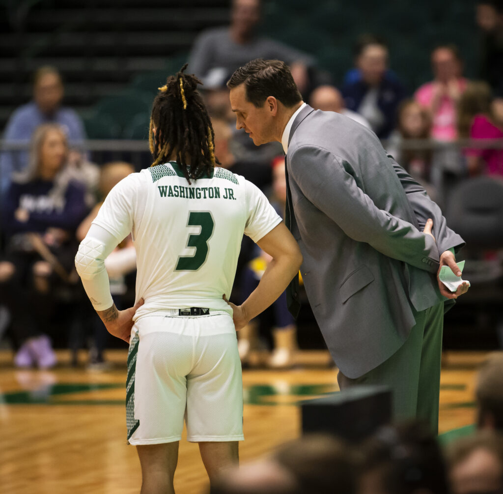 Utah Valley University basketball coach Mark Madsen confers with Wolverine guard TJ Washington during game against Seattle University in the UCCU center on the campus of Utah Valley University in Orem, Utah. Feb. 8, 2020.