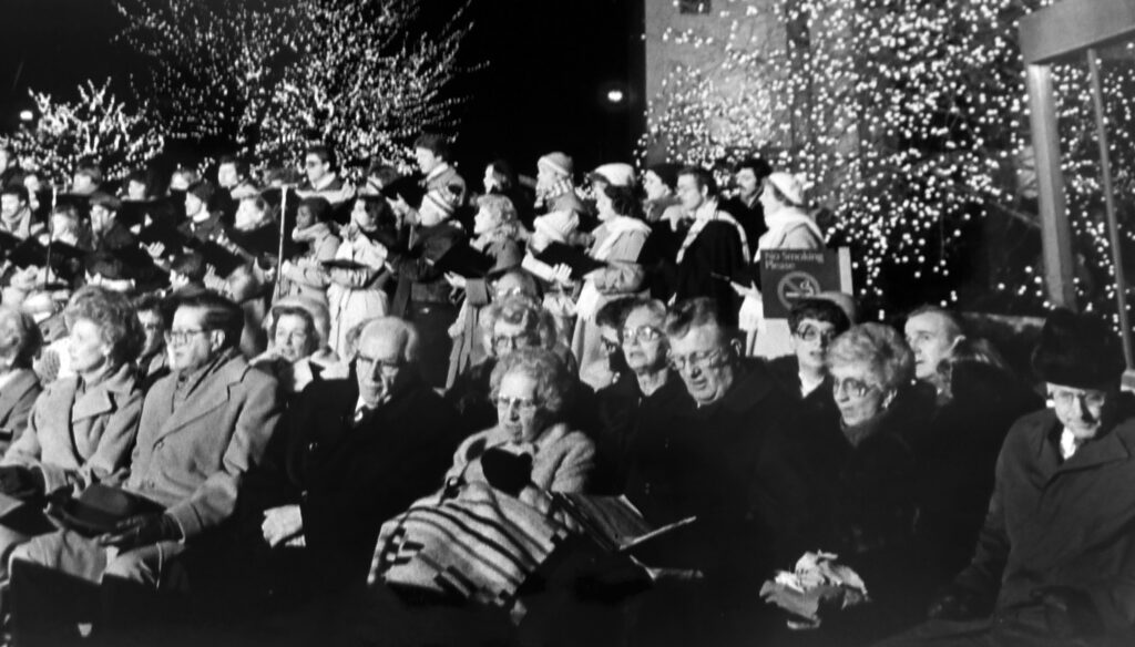 President Ezra Taft Benson and his wife, Sister Flora Benson, sit with other Church Authorities at the opening of the lights on Temple Square on December 1983.