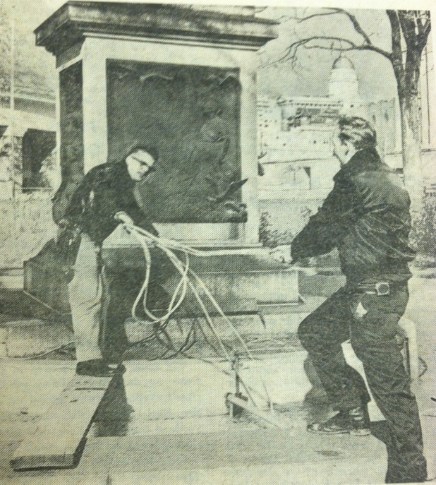 Edgar Larsen, left, and Ned Huntsman arrange Christmas lights and cables at the Seagull Monument in 1966.