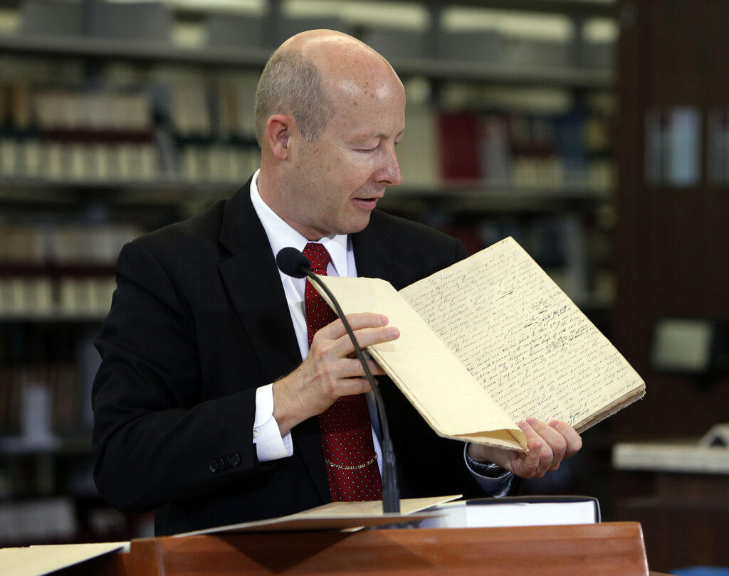 Assistant Church Historian and Recorder Richard E. Turley Jr. displays historical documents during a press conference Sept. 4, 2013, announcing the release of the latest volume in the Church's ongoing Joseph Smith Papers project in Salt Lake City,