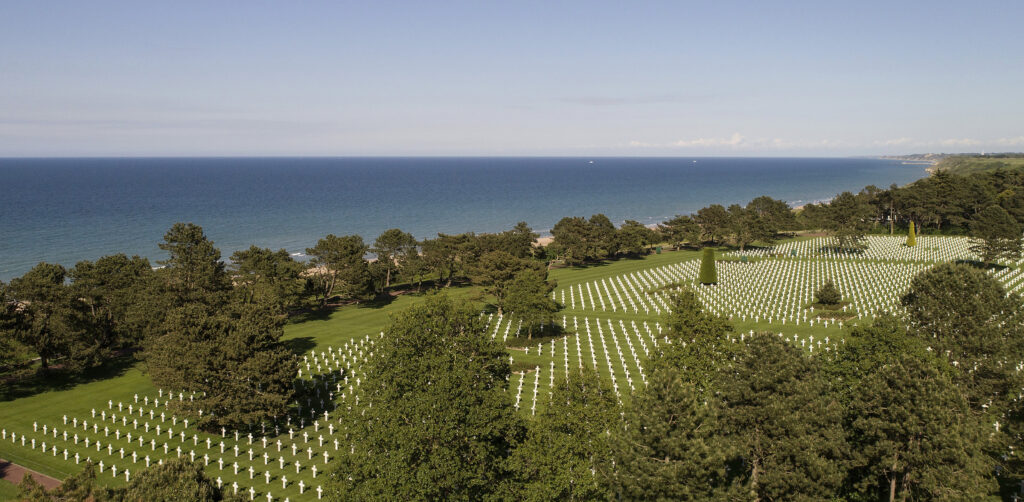 This photo taken on May 28, 2019, with a drone shows crosses at the American Normandy cemetery in Colleville-sur-Mer, Normandy. In the cemetery of Colleville-sur-Mer, where 9,387 fallen U.S. fighters are buried, rows of white crosses are a strong reminder of the sacrifices made by some 156,000 Allied soldiers.