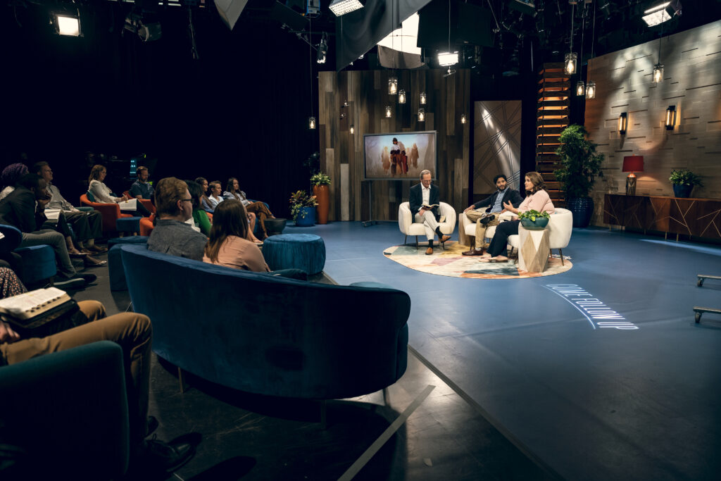 """On the set of """"Come Follow Up"""" with hosts Barbara Morgan Gardner and Daniel Becerra, both faculty members of BYU's Department of Religious Education, and guest [NAME]. The weekly talk show follows the Church's """"Come, Follow Me"""" resource."""