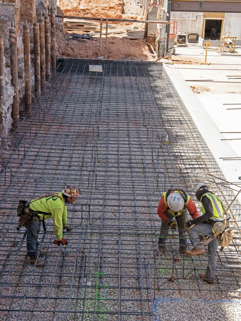 Crews prepare rebar for concrete to connect the old pioneer rock foundation of the St. George Utah Temple to the new north entrance addition in June 2020.
