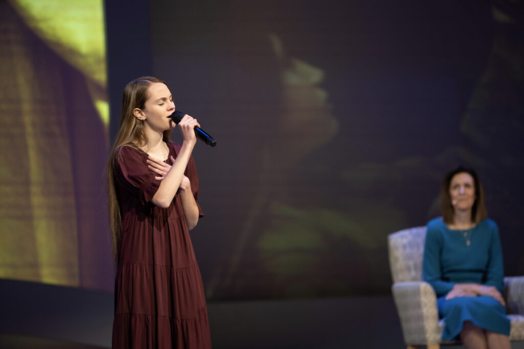 """Kenadi Dodds, a Latter-day Saint from Logan, Utah, sings """"Redeemer of Israel"""" in a Face to Face broadcast with the Church's Young Women General Presidency on Sunday, November 15, 2020. Young women from around the world were invited to participate in the interactive event that celebrates 150 years since the Young Women organization gathered for the first time."""