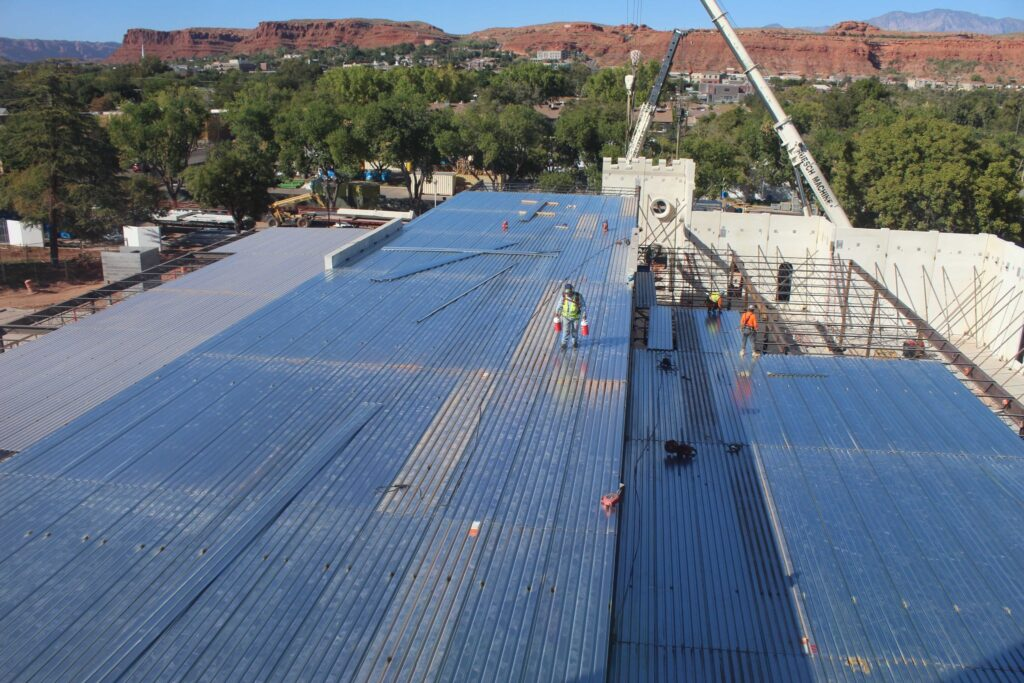 The metal roof of the north entrance addition is fastened into place following the installation of the precast walls of the St. George Utah Temple in September 2020