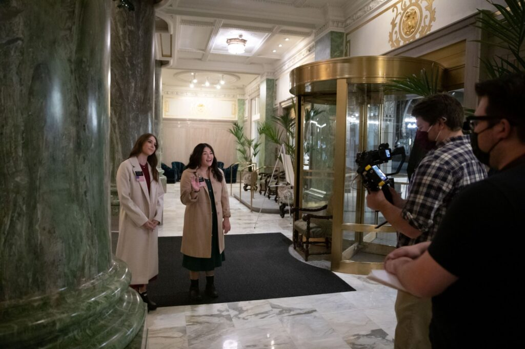 Two Temple Square missionaries record part of a virtual tour that will be shared with the public in place of the traditional in-person experience for visitors that wish to see the Salt Lake Temple's surrounding area during the Christmas season in November 2020.