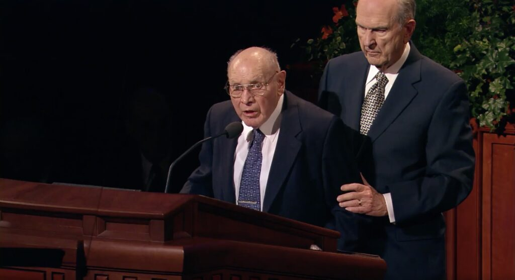 During the Saturday afternoon session of the October 2007 general conference, Elder Joseph B. Wirthlin is assisted by then-Elder Russell M. Nelson, both of the Quorum of the Twelve Apostles, so Elder Wirthlin can finish his address.