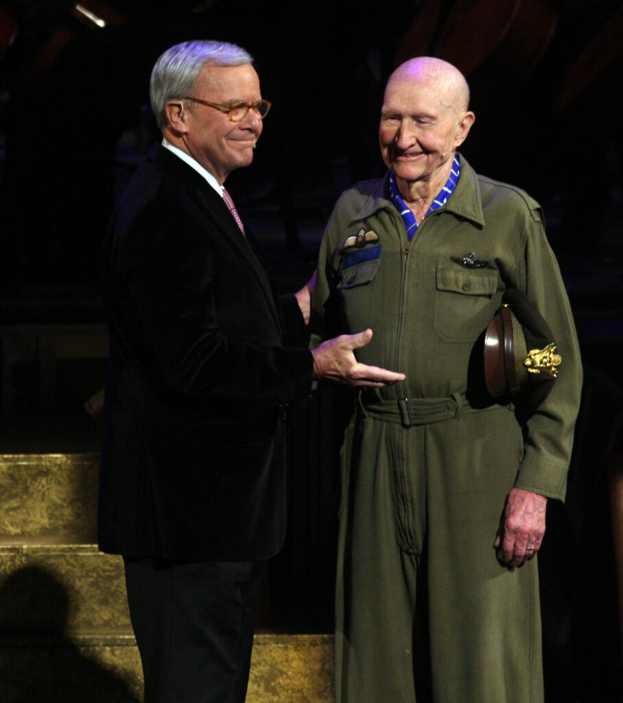 "Tom Brokaw greets Gail Halvorsen, the ""Candy Bomber,"" during the Mormon Tabernacle Choir Christmas concert in Salt Lake City, Friday, Dec. 14, 2012."
