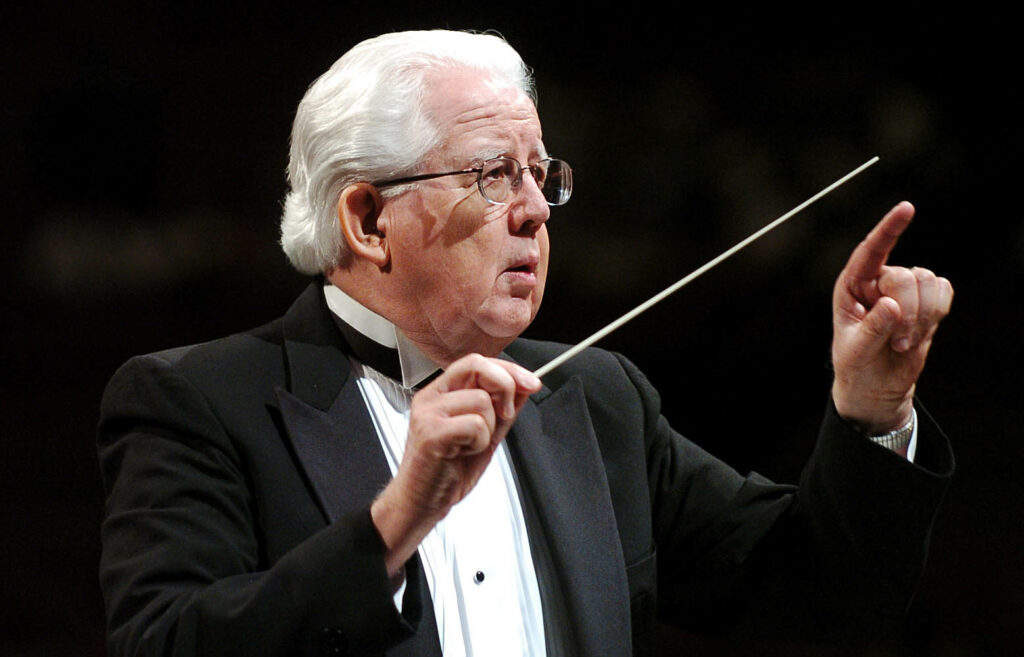 Jerold Ottley conducts during a run through practice performance with the Mormon Tabernacle Choir July 18, 2004, in the Conference Center celebrating their 75th anniversary of their broadcast.