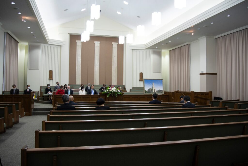 A small group of Latter-day Saint leaders and invited guests gathered in Okinawa, Japan, on Saturday, December 5, 2020, for the groundbreaking of a new temple of The Church of Jesus Christ of Latter-day Saints. Part of the event was held at a meetinghouse adjacent to the temple site.
