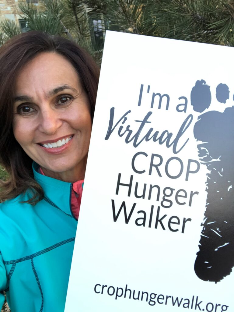 Lisa L. Harkness, a member of the Primary general presidency, raises a CROP Hunger Walk sign to raise awareness about hunger-fighting efforts organized by Church World Service and The Church of Jesus Christ of Latter-day Saints in November 2020 in Utah. During their participation, members of the Church's general presidencies encouraged people to sign up for projects on JustServe.org that will benefit their local food banks and food drives.