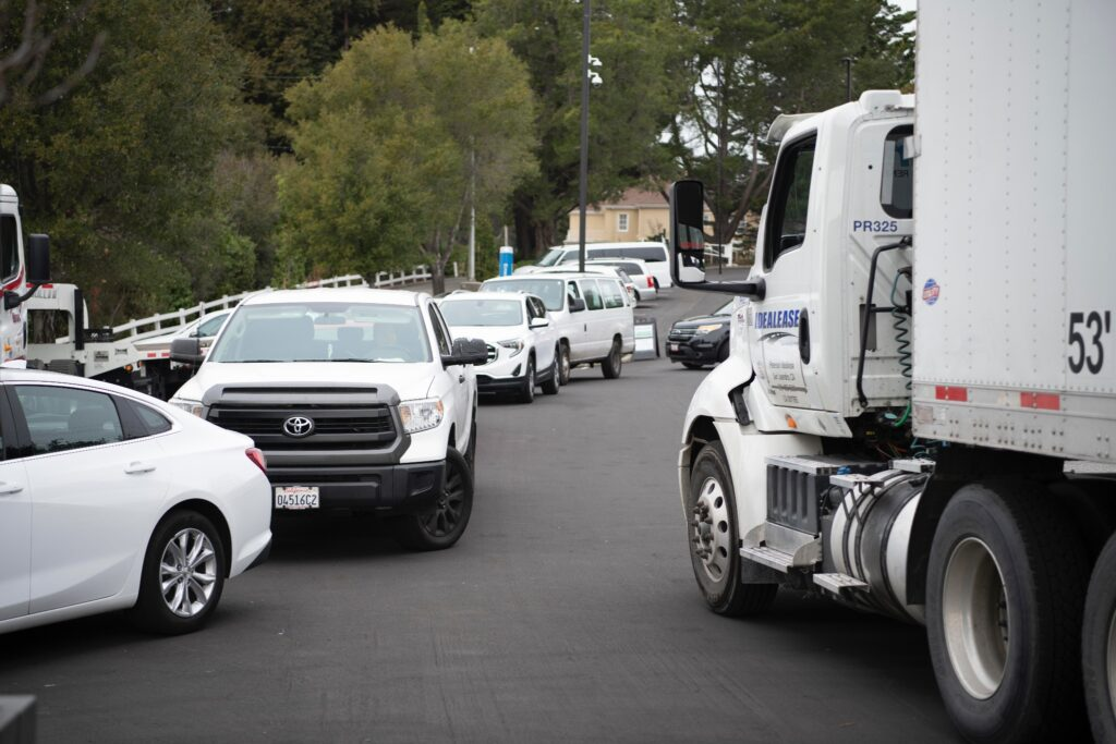 Lines of cars and a parked truck wait their turn to pick up food boxes with fresh produce, meat and other food items in the parking lot of the Oakland California Temple on Friday, Dec. 11, 2020. California state senators reached out to Latter-day Saint Charities, the humanitarian arm of the Church, for assistance with food distribution to community organizations that serve people facing economic hardship.
