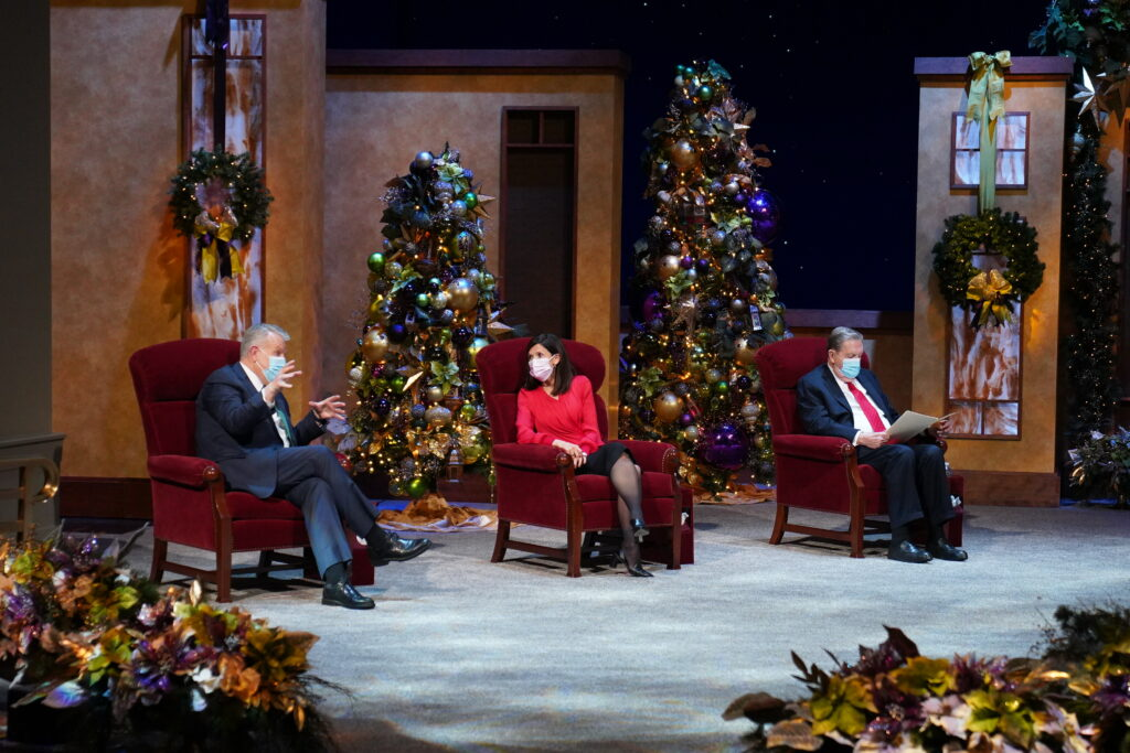 Elder Brent H. Nielson of the Presidency of the Seventy, left, talks with Sister Becky Craven of the Young Women general presidency prior to the start of the First Presidency Christmas Devotional on Sunday, Dec. 6, 2020.