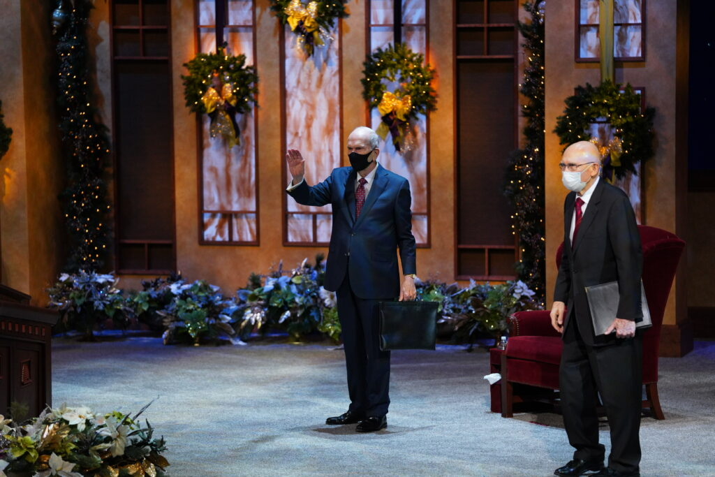 President Russell M. Nelson, left, waves after the First Presidency Christmas Devotional broadcast from the Conference Center Theater in Salt Lake City on Sunday, Dec. 6, 2020. President Dallin H. Oaks, right, conducted the program.