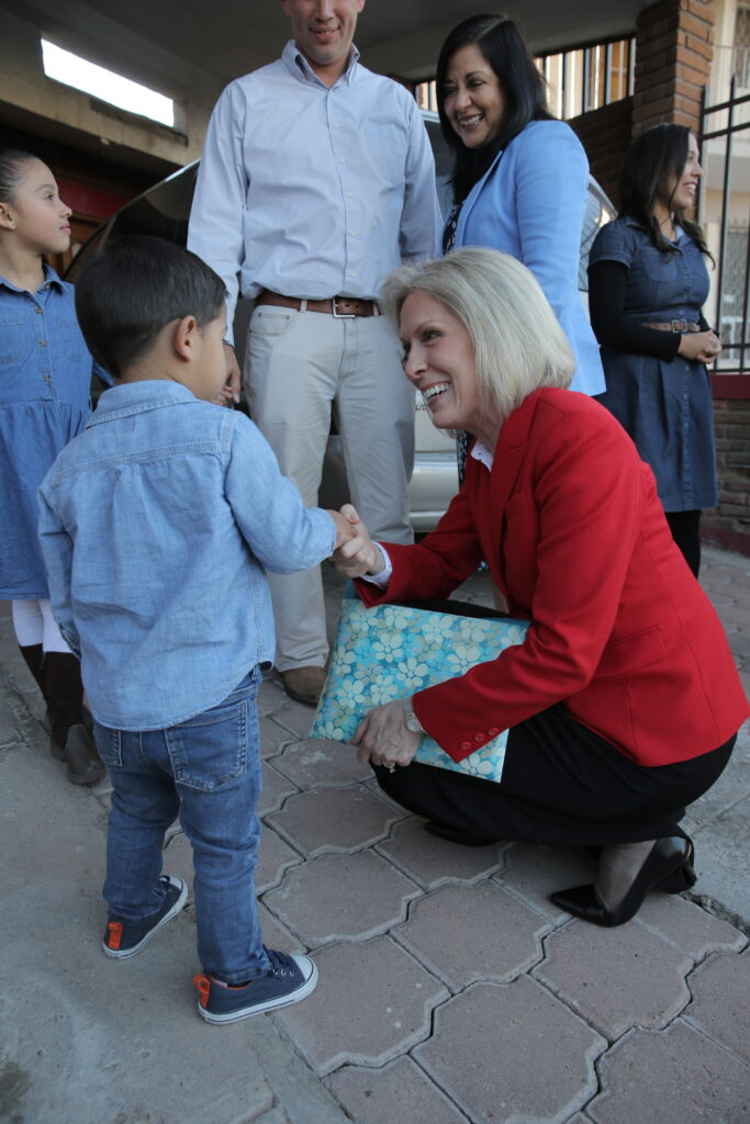 Sister Joy D. Jones greets a young Primary child during a ministering visit with families in the Mexico Area in December 2019.