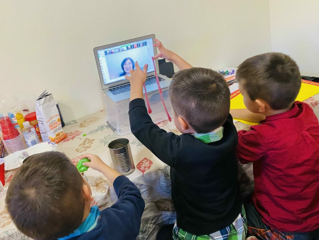 """Heidi Valente of the Mount Ensign 2nd Ward said, """"While it may be that they are playing with slime at the table and having snacks, this is our virtual primary time, singing songs and learning about the gospel! It's always fun to be together as a family."""""""