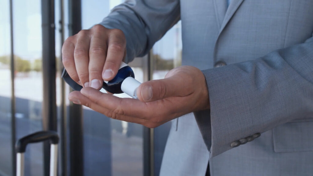 A man uses hand sanitizer, as shown in a video message accompanying the Dec. 7, 2020, announcement of the Church's first four temples moving to Phase 3 of reopening, allowing for proxy temple ordinances for deceased individuals.