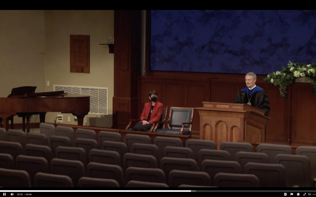 Elder David A. Bednar of the Quorum of the Twelve Apostles addresses an empty auditorium as his address is broadcast to BYU–Idaho graduates during online commencement exercises on Dec. 16, 2020.