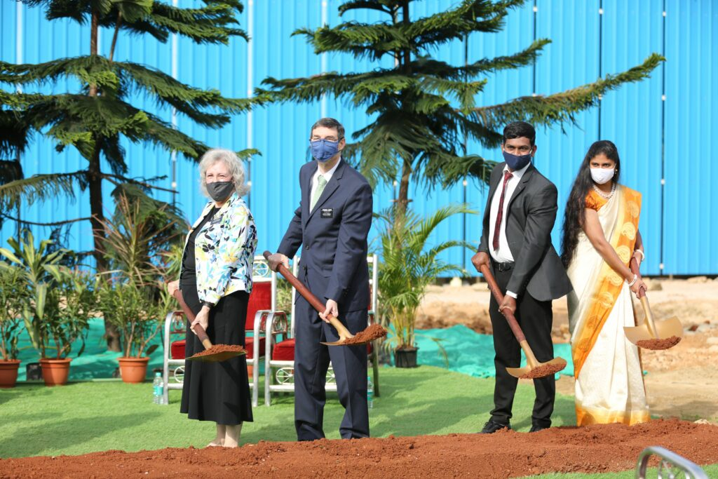 India Bengaluru Mission President Ted A. Thomas and his companion, Sister Karen K. Thomas, left, and India Bengaluru Stake executive secretary Sharath Prasad and his wife, Hema Prasad, right, turn the soil together at the Bengaluru India Temple groundbreaking ceremony Wednesday, Dec. 2, 2020.