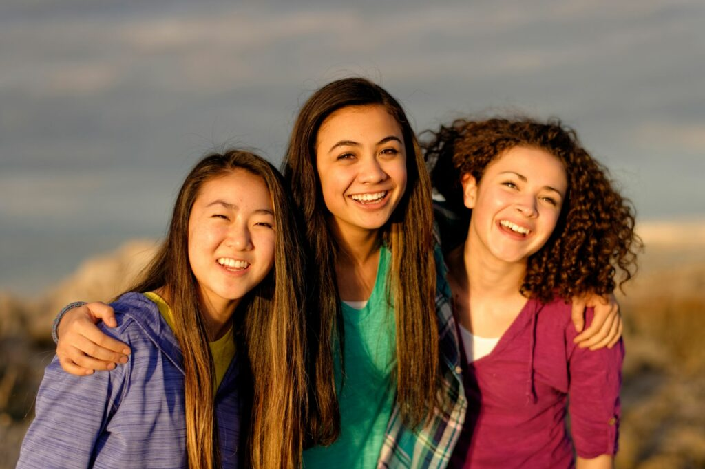 A trio of young women enjoy an outdoor activity. General youth leaders say January is the ideal month to plan 2021 Young Women and Young Men activities, as circumstances and policies allow.
