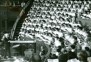 Former director Jerold Ottley conducts choir during general conference session in 1989. In accepting hall of fame induction, director Mack Wilberg acknowledged that thousands have contributed to choir's success over the years.