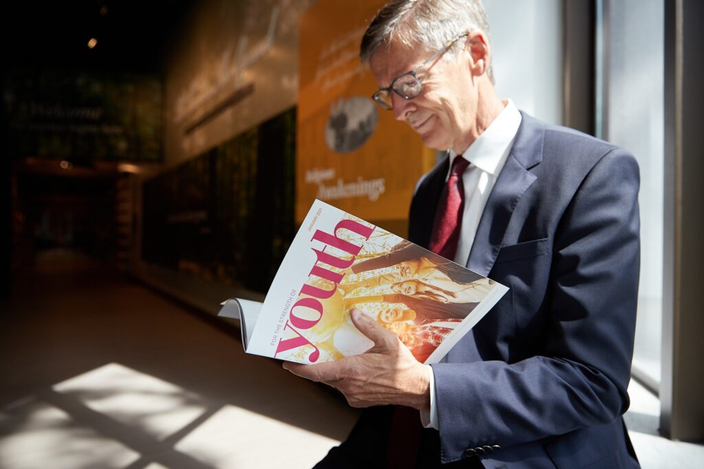 Steven J. Lund, Young Men general president, looks through a print edition of the For Strength of Youth magazine at the Church History Museum on Wednesday, August 5, 2020.