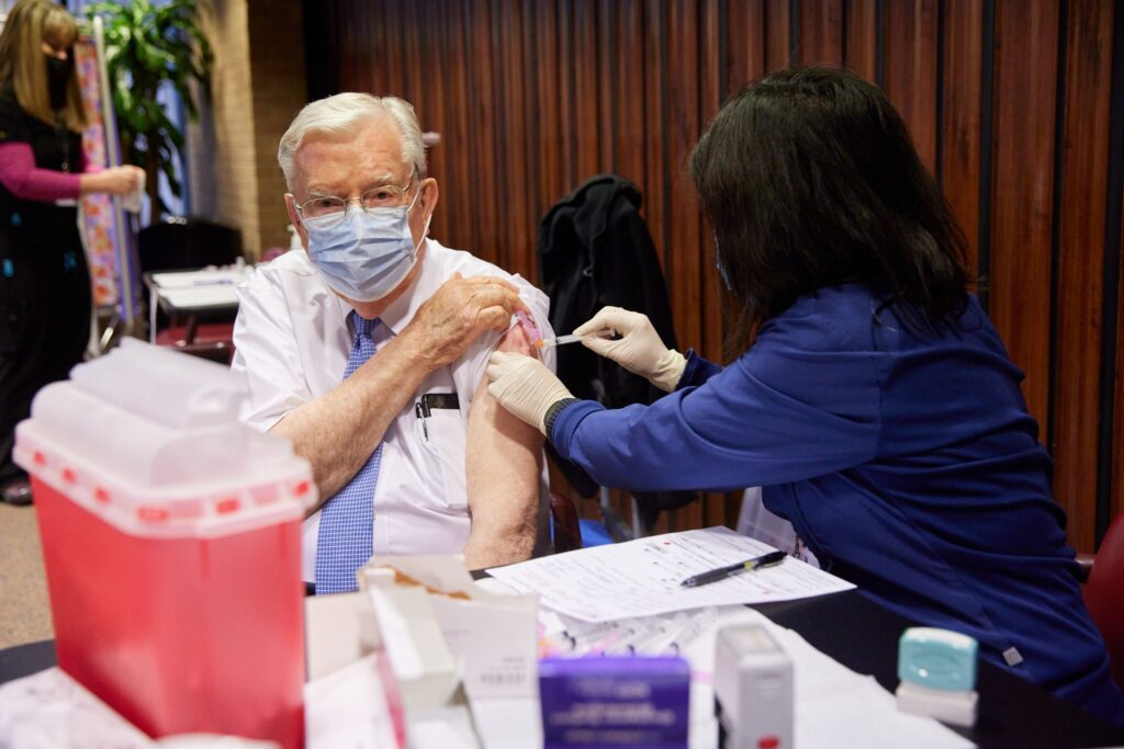 President M. Russell Ballard of the Quorum of the Twelve Apostles receives the first dose of a COVID-19 vaccine Tuesday, January 19, 2021, in Salt Lake City.