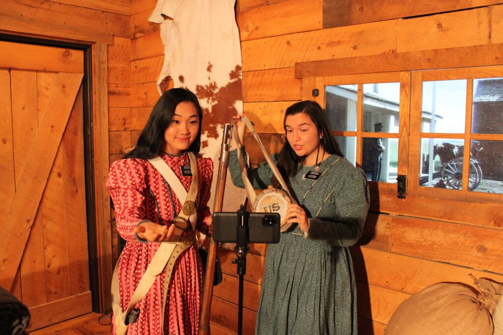 Sister Sarah Sun and Sister Pamela Wach showcase authentic clothing during a virtual tour of the Mormon Battalion Historic Site. Because of COVID-19, Church historic sites have been closed to in-person visitors since March 2020.