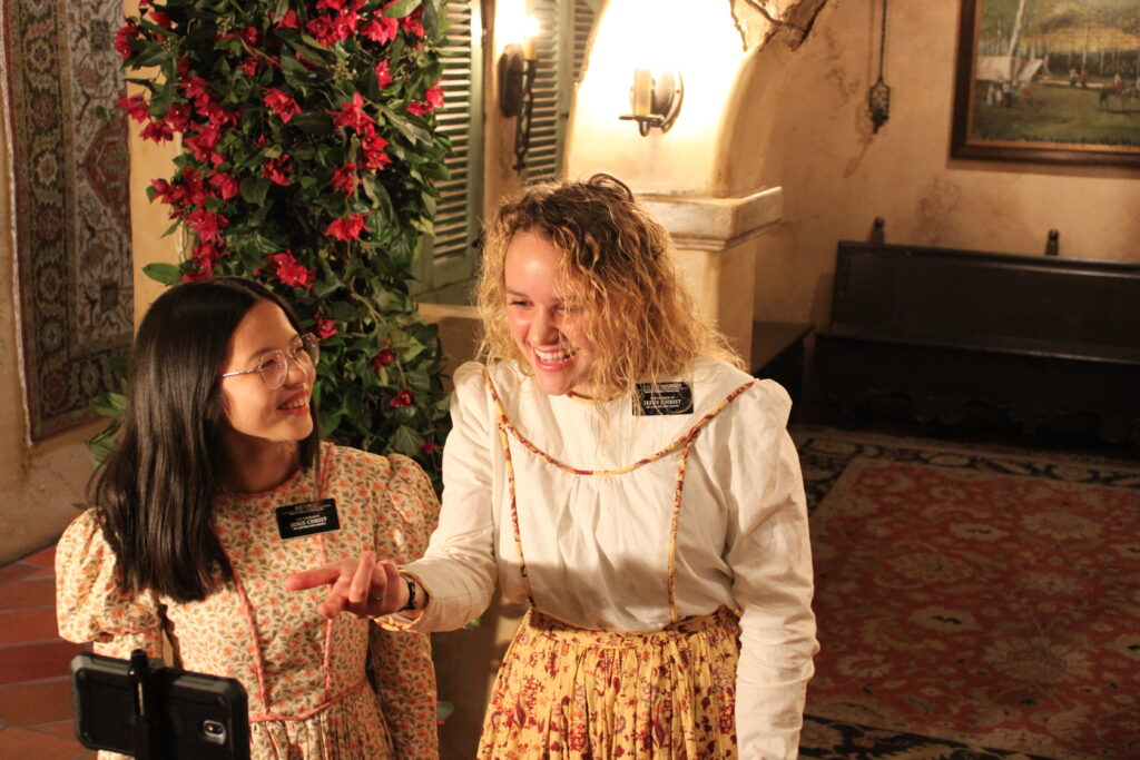 Sister Guo You Li and Sister Sydney Warner help give a virtual tour of the Mormon Battalion Historic Site.