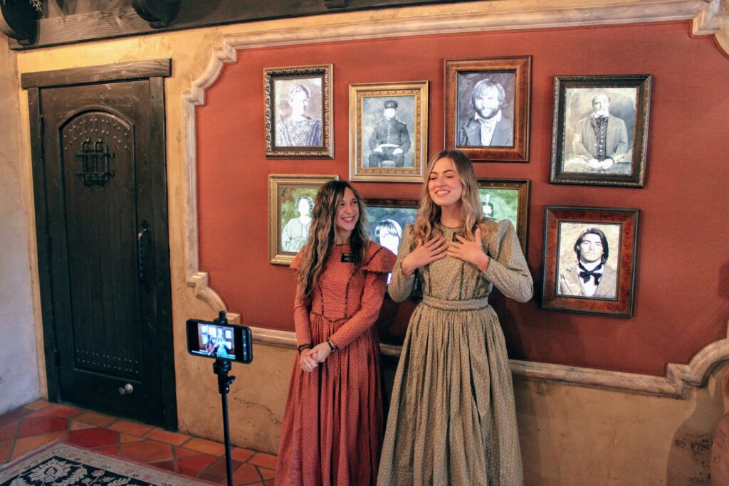 Sister Jessa Lethbridge and Sister Hannah Van Holten welcome virtual visitors to the Mormon Battalion Historic Site in San Diego, California.