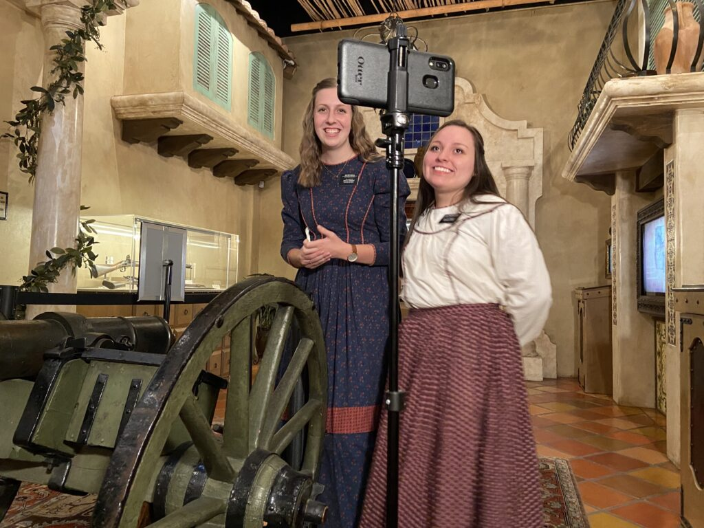 Sister Caelie Noall and Sister Isabella Rich show virtual visitors some of the artifacts found in the Mormon Battalion Historic Site. Because of COVID-19, Church historic sites have been closed to in-person visitors since March 2020.