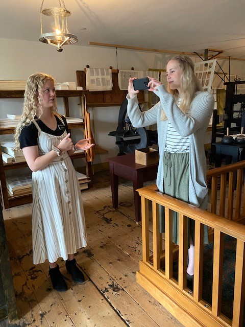 Sister Shaylee Dye and Sister Gabrielle Iverson conduct a virtual tour of Grandin Building at the Book of Mormon Publication Site. Missionaries are conducting virtual tours of historic sites since their closure to visitors in March 2020 due to COVID-19 pandemic.