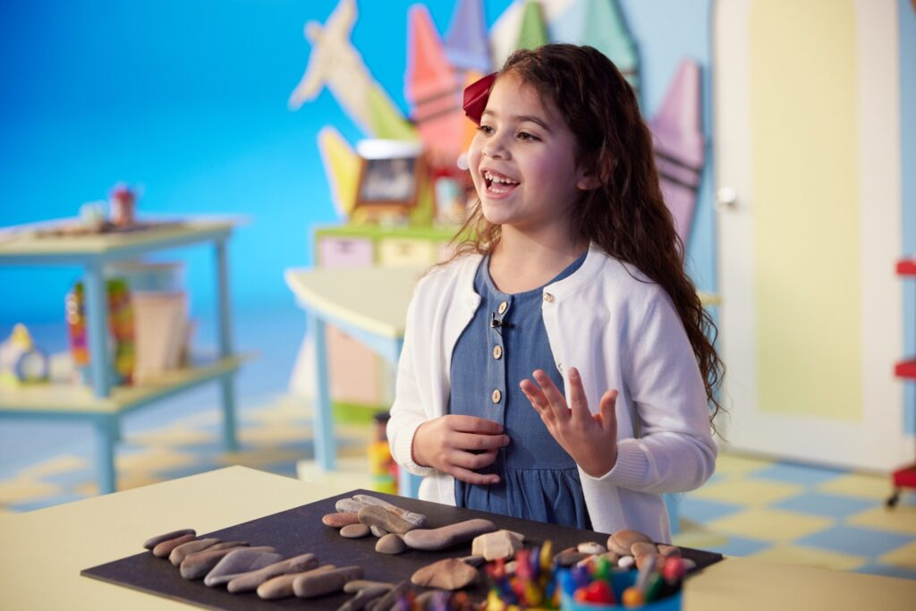 Seven-year-old Brianna Villsnill from Salt Lake City, Utah, stands behind a table set up for a rock activity Jan. 21 at the Church's Motion Picture Studio in Provo, Utah.