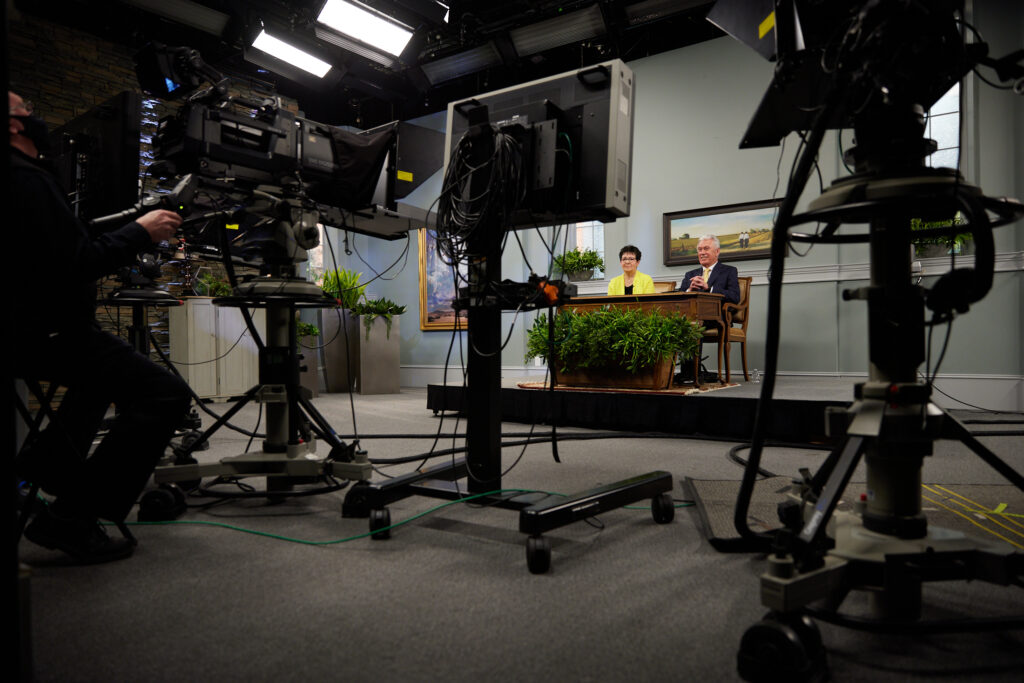 Elder Dieter F. Uchtdorf of the Quorum of the Twelve Apostles of The Church of Jesus Christ of Latter-day Saints and his wife, Sister Harriet R. Uchtdorf, address missionaries during a devotional, broadcast on Feb. 25, 2021.